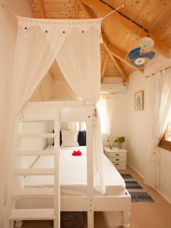 Guest bedroom- comprised of single bunk bed above double bed