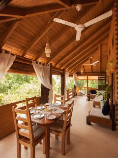 Veranda- with sea view with dining table