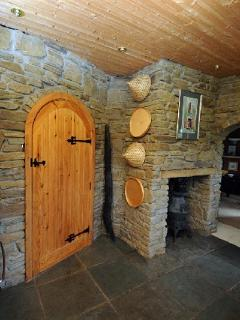 The handmade doors, internal stone walls and pot belllied stove in the kitchen.