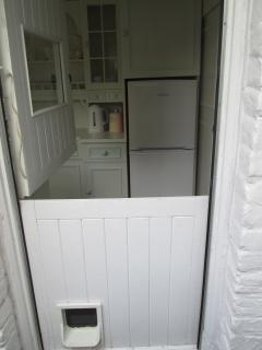 Stable doors that lead from the back garden into the kitchen.