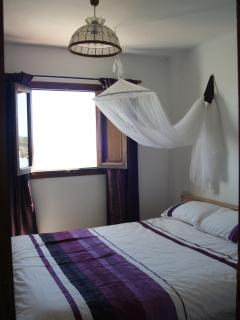 Double Bedroom with traditional shutters for the perfect midday siesta!