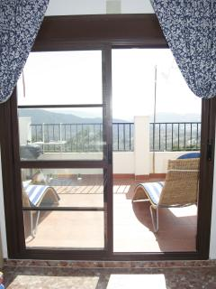 View onto terrace from bedroom/sun room