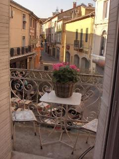 Enjoy a glass of wine at the balcony watching people (though not on this picture there will be many)