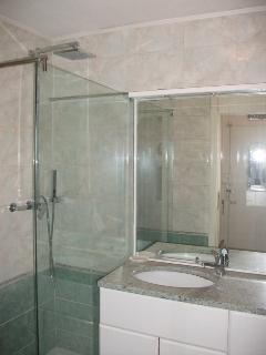 bathroom with shower, bidet and wahing machine
