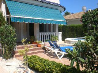 Front of House with veranda and sunbeds