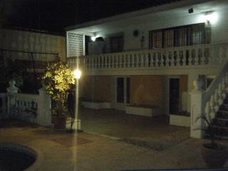 night view of back terrace/pool