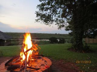 enjoy sun-downers around a bush fire