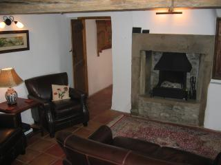 A lovely sitting room full of great character.  Open fire and original exposed beams.