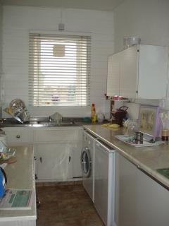 Kitchen well equiped with hatch to dinnig Room