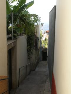 Access the apartment via garden gate on the left from the public alleyway. The view down over city