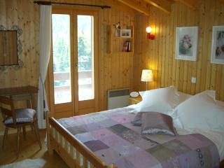 Master bedroom leading to balcony