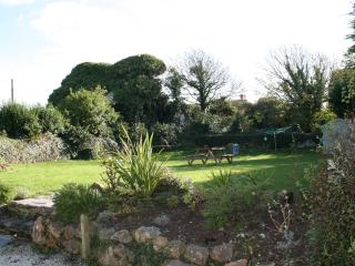 Large private enclosed garden backing onto old windmill