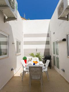sunny courtyard with dining facilities and BBQ