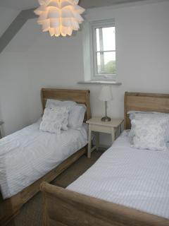 Upstairs twin bedroom with ensuite shower room