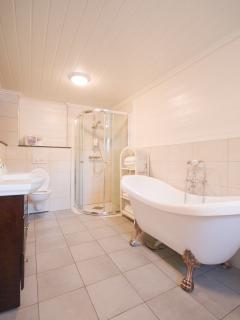 Large bathtub and shower corner.