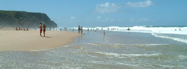 Praia Grand beach, popular for surfing. 15 minutes walk, past neolithic cliff-top remains