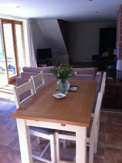 Painted oak dining table & chairs.