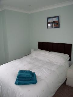 Bedroom one with double bed