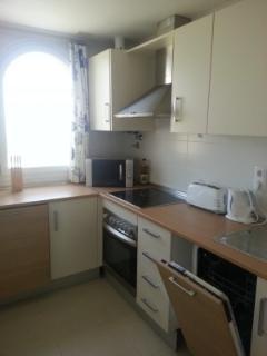 kitchen with dishwasher, washing machine and large American fridge frezer