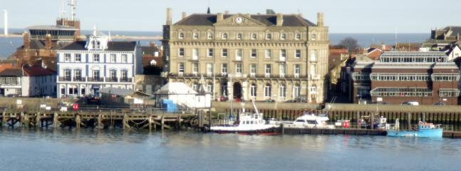 The Quayside and pier from the sea, a must to visit during your stay