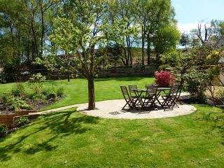 Secluded 1/4 acre garden with the open forest beyond