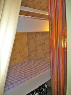 Chambre enfants, lits superposés.