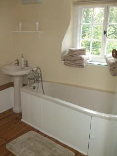 Bathroom with 'coffin' shaped bath