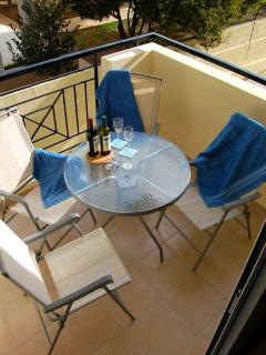 Enjoy Alfresco dining on the private balcony