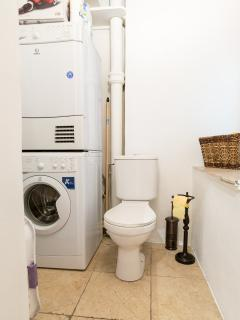 Separate toilet with machine machine and dryer machine