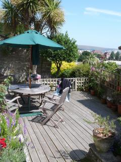 Baytree sundeck/patio with seaview leading to garden