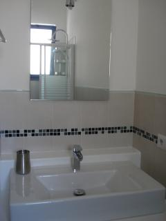 Modern self designed 3 set pieces bathroom with shower, bidet and toilette. Sliding Door