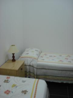Double room with two single bed and wardrobe