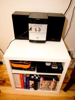 Stereo with DVD player (and cable to plug in your own music), films, books and games