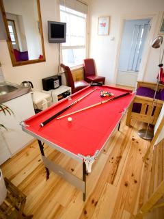 Quick game of pool or ping pong? Doubles up as extra dining and can be stored away