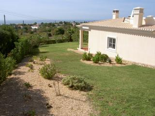 The villa has large private gardens and is situated on small, private complex