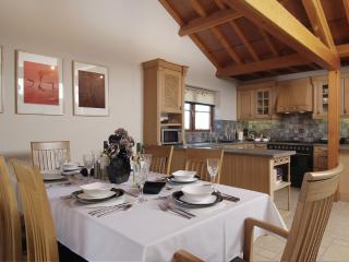 Spacious kitchen/dinner seats six in comfort with patio doors to private patio and walled garden