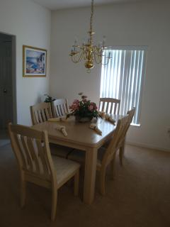 Formal Dining Area seats 6, perfect for a family gathering.