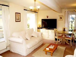 Lounge/dining area-- 2 sofas and Sky tv