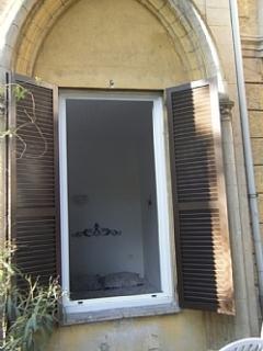 Bedroom through garden window
