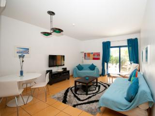Spacious living area with Flat screen TV, UK Satelitte, preloaded media and private spacious patio