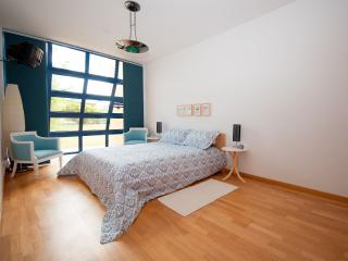 Bright and spacious bedroom with travel cot and a spacious security safe for your belongings