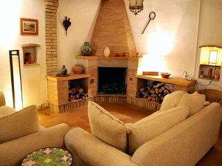 Spacious but very  cosy sitting area with big log fire