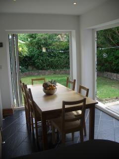 Breakfast area - Extending table. Beautiful Outside/Inside living with foldable doors