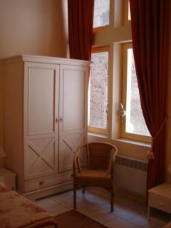 Classic windows look onto 14th century atrium in second bedroom.