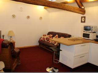 Lounge area, leather 3 seat settee + single seater,  freeview tv + dvd player