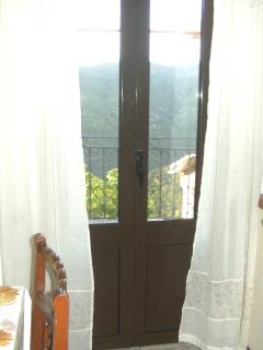 French doors to balcony from kitchen