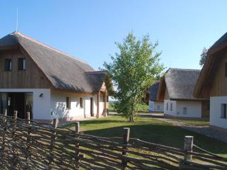 Straw roof cottages near golf