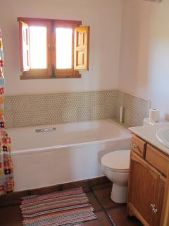 Upstairs bathroom with bath and stunning views to back valley