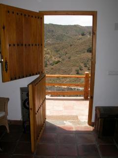 Open plan living room showing view through back door