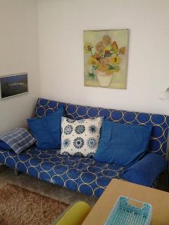 sofa cama en sala de 1,35 cm